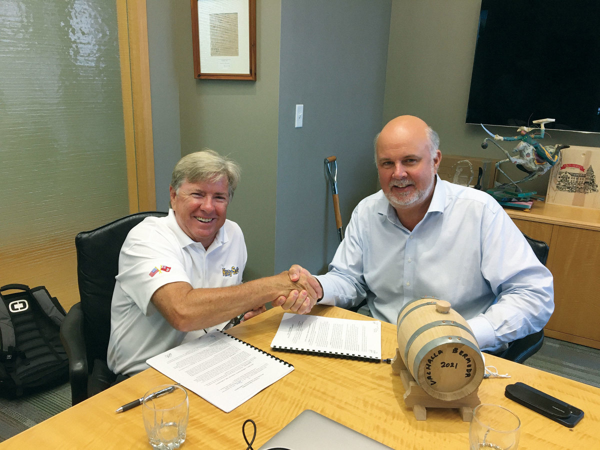 To seal the deal, Waterfront Group president William Cox (right) gave Viking president and CEO Pat Healey a barrel of special-blend rum from acclaimed Harry's Restaurant and Bar. caption here for both images,