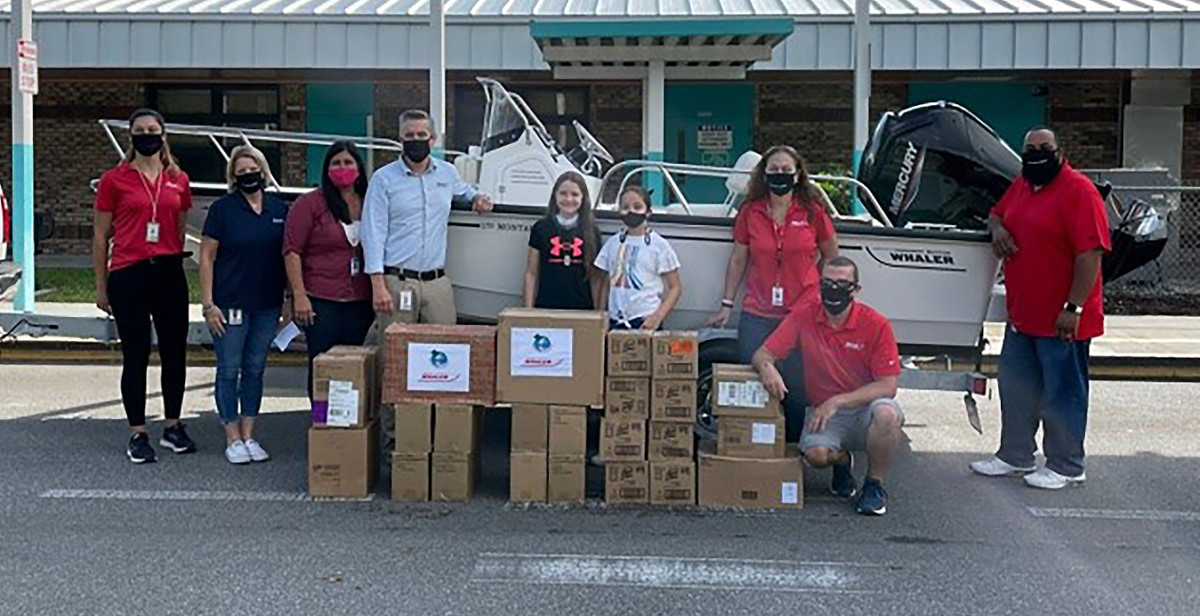 The team from Boston Whaler, including director of business systems Nathan Abdalian and purchasing manager Kim Shaller, greeted students and staff.